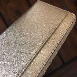 kate spade Bags - Kate spade gold Cameron street wallet